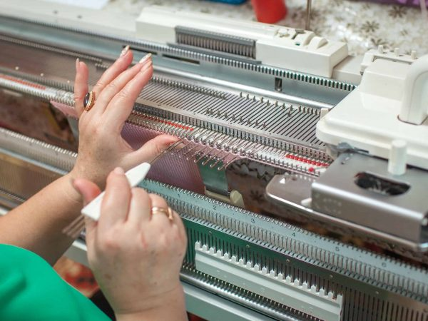 knitting machine, woman working with hands