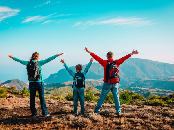 happy family-mom, dad and son-travel in nature, hiking in nature